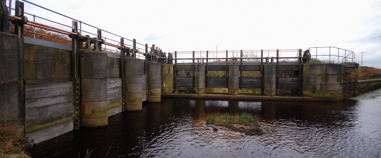 sluice gates to control the flow of water at the confluence